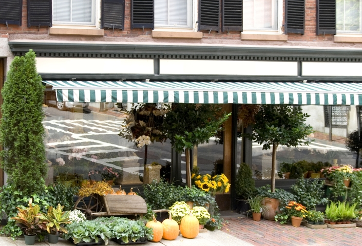 Shop front awnings create a dry outdoor area for customers