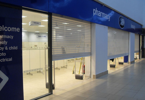 Open punched grilles protect glass shop fronts whilst still letting in natural light